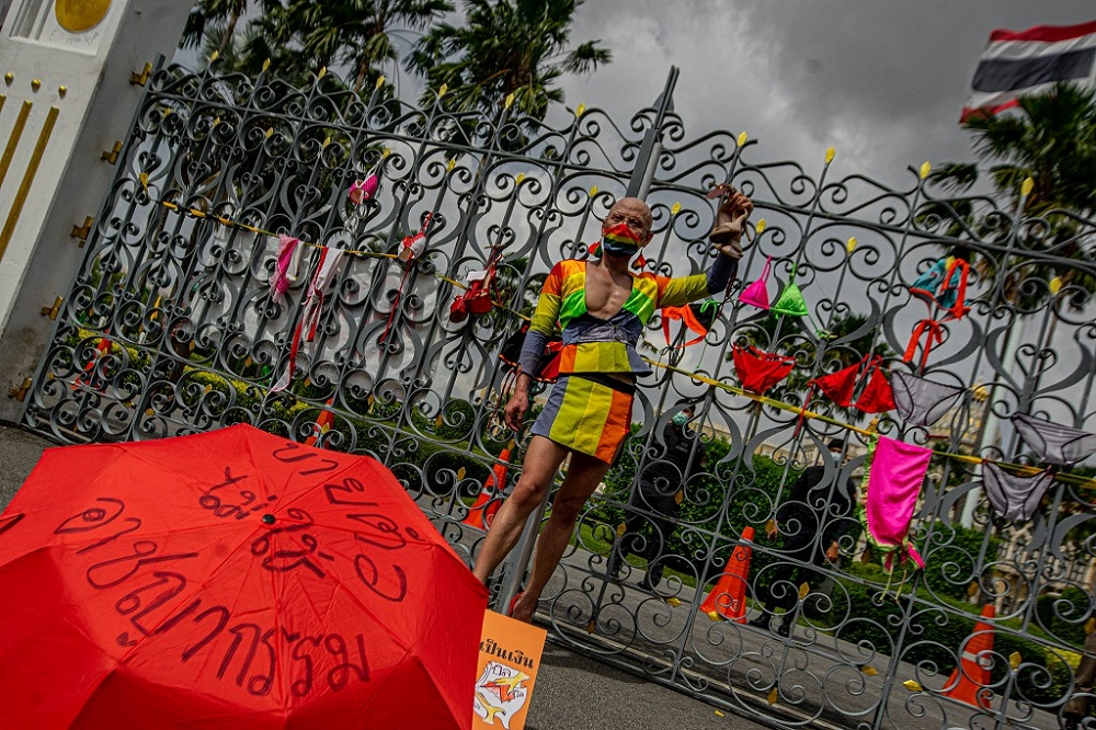 A protester stands in front of Thailand's Government House demanding for compensation during Covid-19 closures. ― Picture via Facebook/iLaw