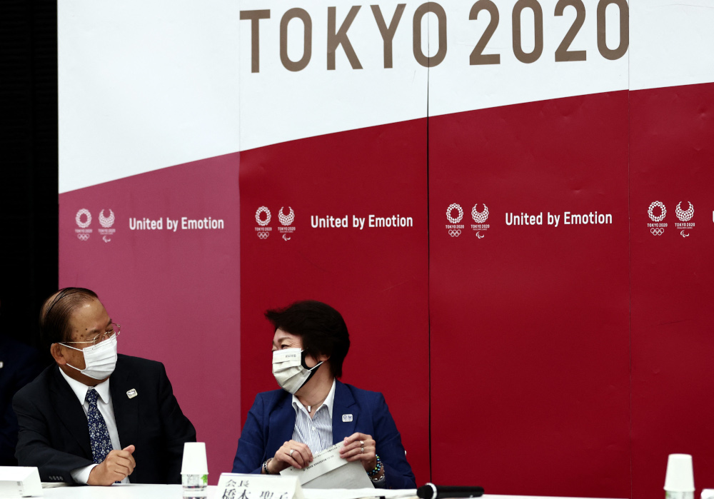 Tokyo 2020 President Seiko Hashimoto (right) and CEO Toshiro Muto chat before the start of the Tokyo 2020 Olympic Games' executive board meeting in Tokyo June 8, 2021. — AFP pic