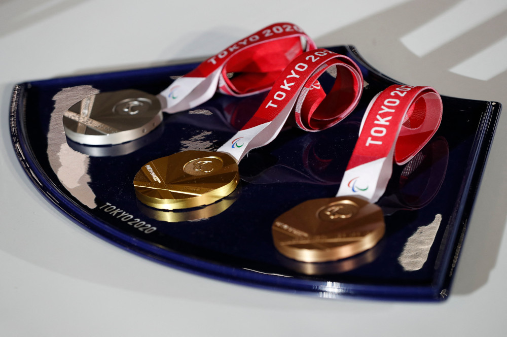 The medals and tray to be used for the medal ceremonies at the Tokyo 2020 Olympics Games are seen during an event to mark 50 days to the opening ceremony, at Ariake Arena in Tokyo June 3, 2021. — AFP pic