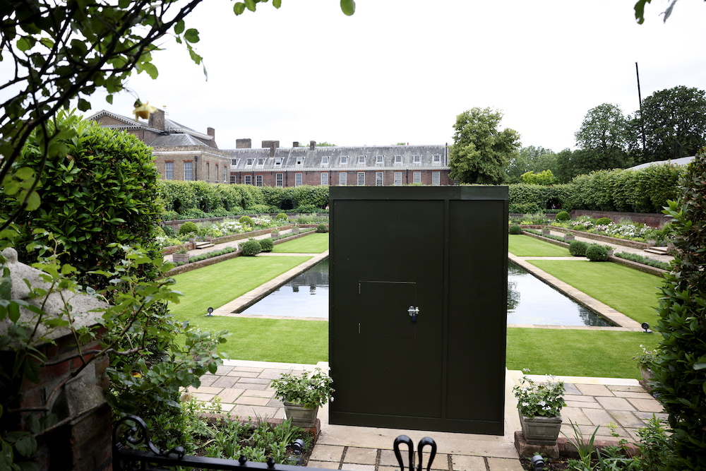 A box covers the statue of Britain's Princess Diana installed in the Sunken Garden of Kensington Palace in London, Britain, June 30, 2021. — Reuters pic