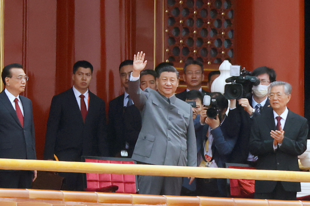 Chinese President Xi Jinping waves next to Premier Li Keqiang and former president Hu Jintao at the end of the event marking the 100th founding anniversary of the Communist Party of China, on Tiananmen Square in Beijing, China July 1, 2021. — Reuters pi