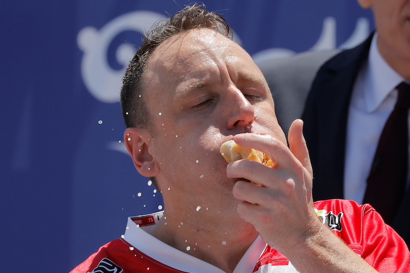 Joey Chestnut competes during Nathan's Famous Fourth of July Hot Dog-Eating Contest held at Maimonides Park in New York City, New York July 4, 2021. — Reuters pic