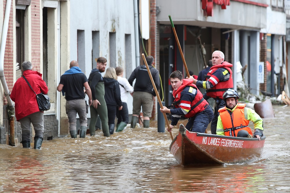 Austrian rescue team members pole their boat as they go through an area affected by floods, following heavy rainfalls, in Pepinster, Belgium July 16, 2021. — Reuters pic