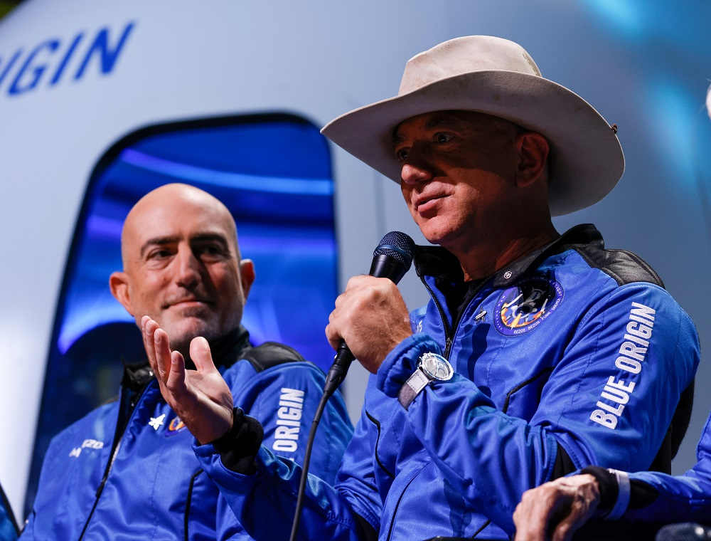 Billionaire American businessman Jeff Bezos speaks with his brother Mark at a post-launch press conference after they flew on Blue Origin's inaugural flight to the edge of space, in the nearby town of Van Horn, Texas July 20, 2021. — Reuters pic