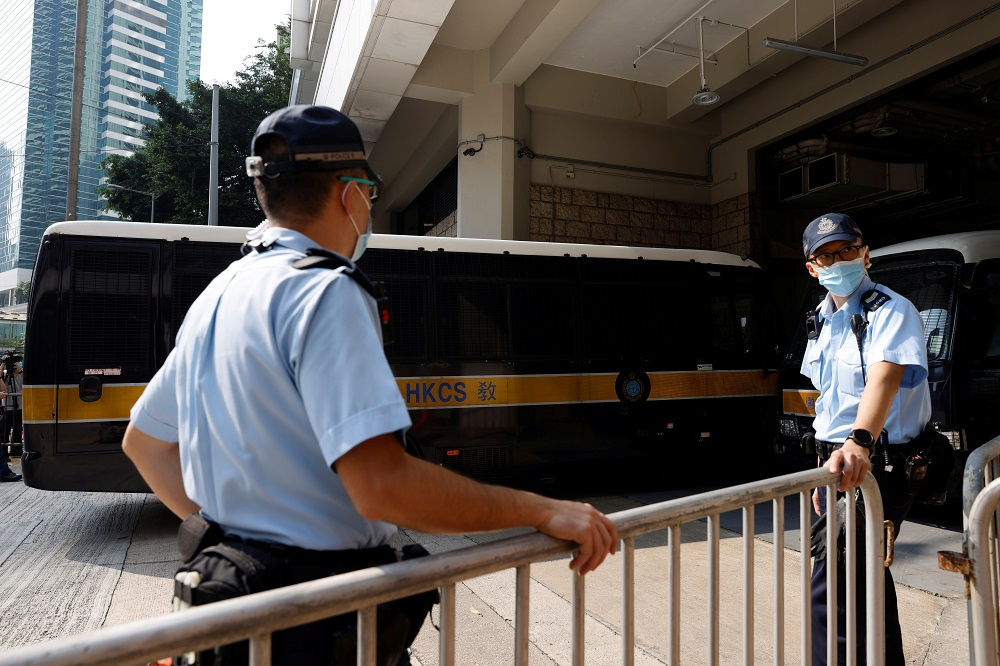 A prison van carrying Tong Ying-kit, the first person charged under the new national security law, arrives at High Court for a hearing, in Hong Kong July 27, 2021. — Reuters pic