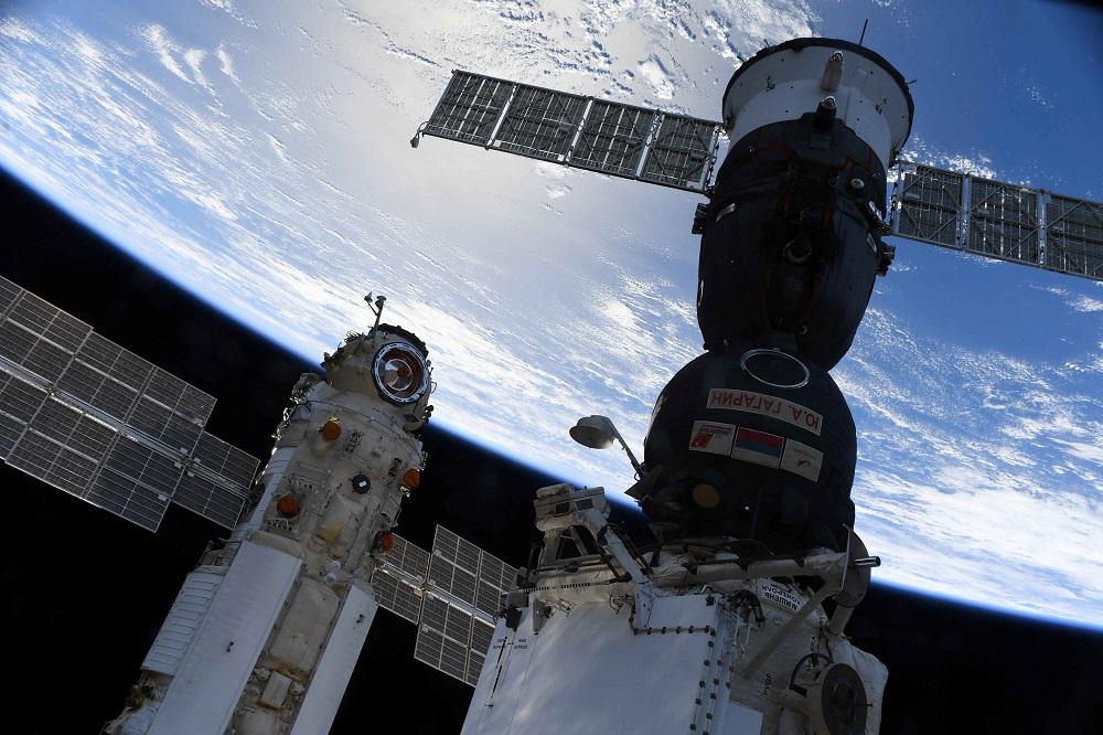 The Nauka (Science) Multipurpose Laboratory Module is seen docked to the International Space Station (ISS) next to next to Soyuz MS-18 spacecraft on July 29, 2021. — Oleg Novitskiy/Roscosmos/Handout via Reuters