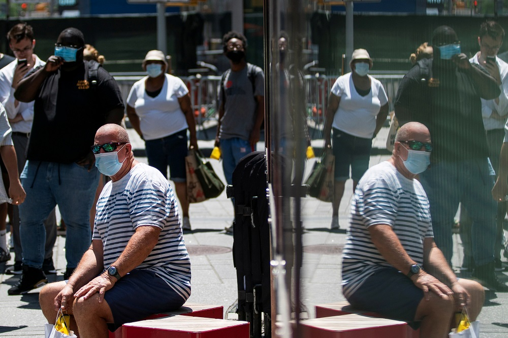 People wear masks to prevent against the spread of coronavirus disease as the highly transmissible Delta variant has led to a surge in infections, in New York July 30, 2021. — Reuters pic