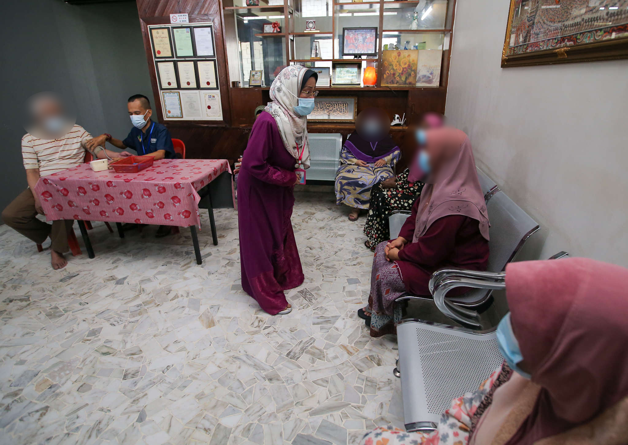 Fitrah Nursing Care founder Fatimah Abdullah (entre) said there are 58 residents at their home. — Pictures by Farhan Najib