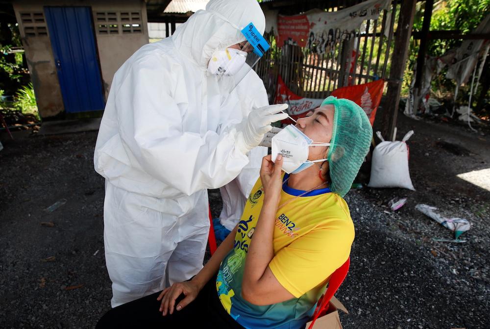 Public health officers bring coronavirus disease (Covid-19) swab testing to residents living in remote communities, in Samut Prakan, near Bangkok, Thailand, July 19, 2021. — Reuters pic