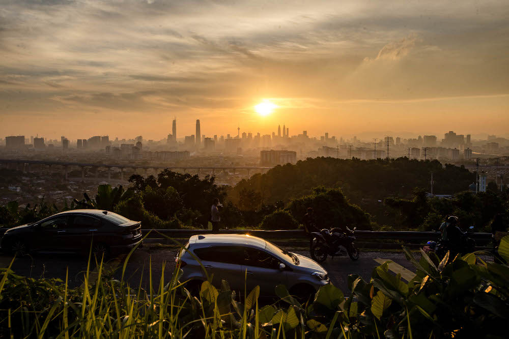 A general view of Bukit Ampang lookout point as the sun sets over the Kuala Lumpur skyline in Ampang July 20, 2021. — Picture by Firdaus Latif