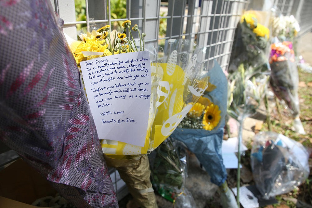 A message offering encouragement and support was seen on a bouquet of flowers placed at the main gate of River Valley High School in Singapore July 25, 2021. — TODAY pic