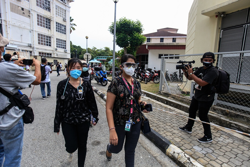Doctors clad in black stage a walkout at the Penang General Hospital July 26, 2021. — Picture by Sayuti Zainudin