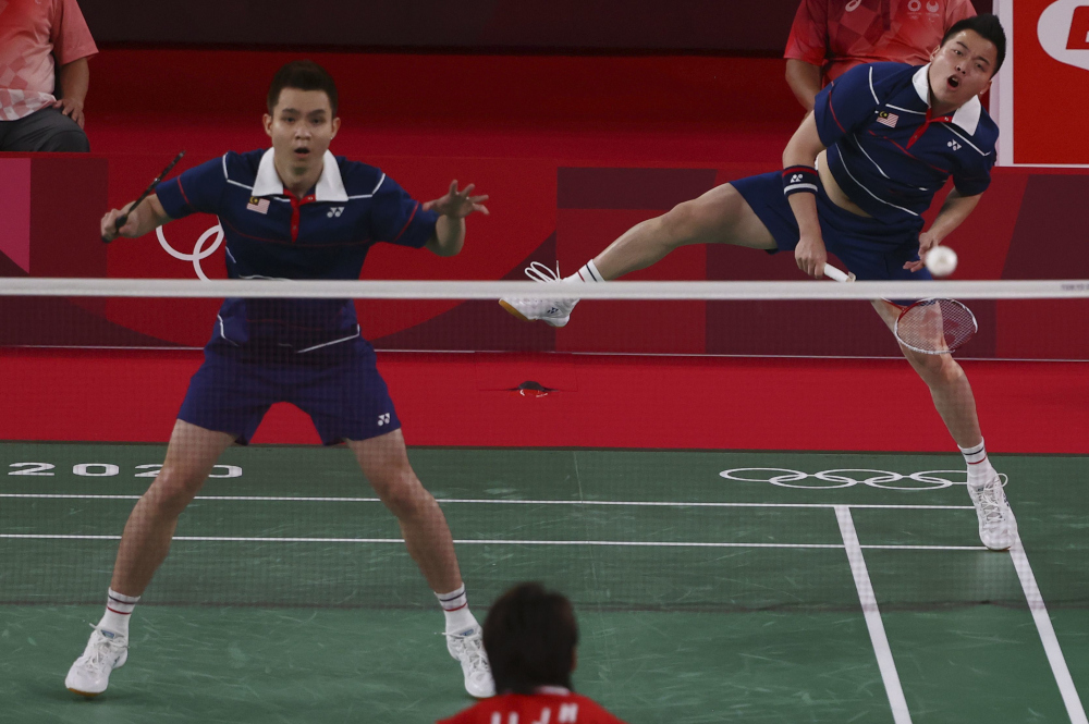 The pair, ranked number nine in the world, described their first-game defeat as the turning point of the match, with the Chinese pair then majestically romping home to a 24-22, 21-13 win at the Musashino Forest Sport Plaza. — Reuters pic