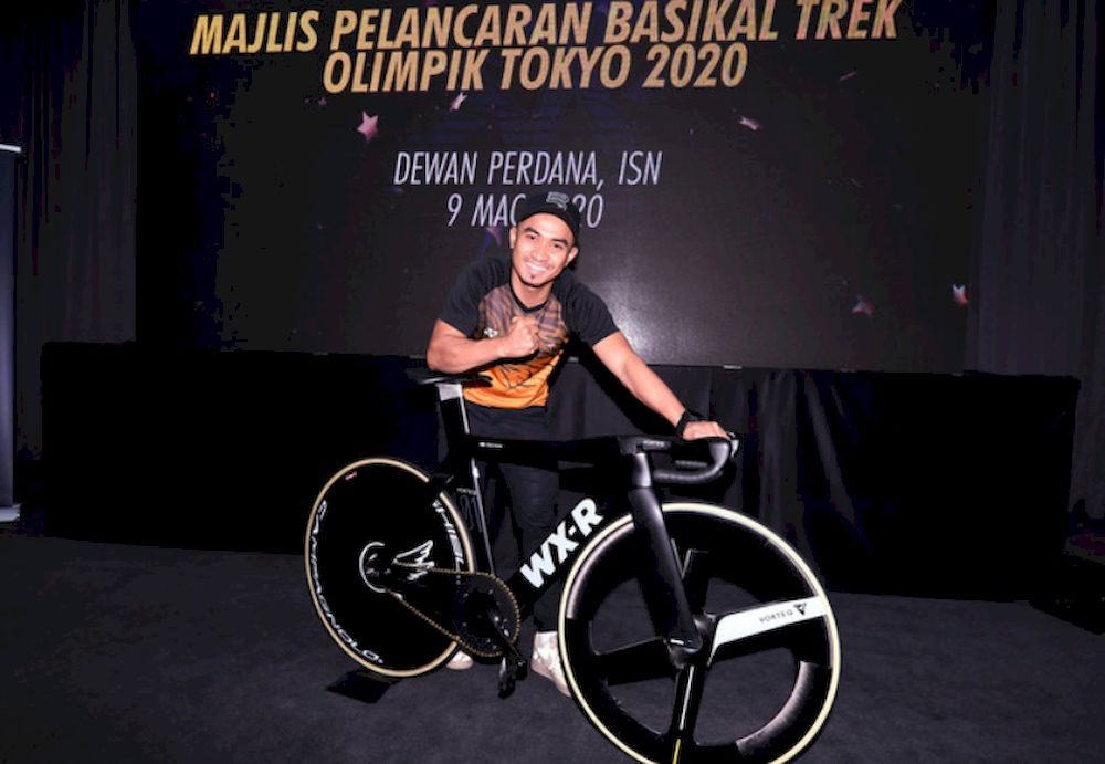 National cycling champion Mohd Azizulhasni Awang posing with the Tokyo 2020 Olympic track bike after its launching ceremony at the National Sports Institute March 9, 2020. — Bernama pic