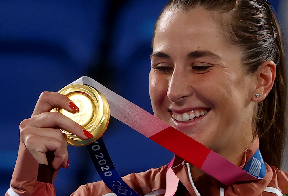 Gold medallist Belinda Bencic of Switzerland celebrates on the podium during the medal ceremony at the Ariake Tennis Park in Tokyo, July 31, 2021. — Reuters pic
