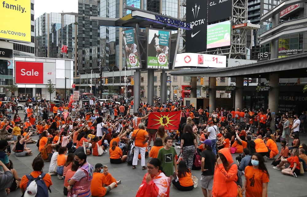 People occupy space at Yonge-Dundas Square, after the discovery of hundreds of remains of children at former indigenous residential schools, on Canada Day in Toronto, Ontario, Canada July 1, 2021. ― Reuters pic