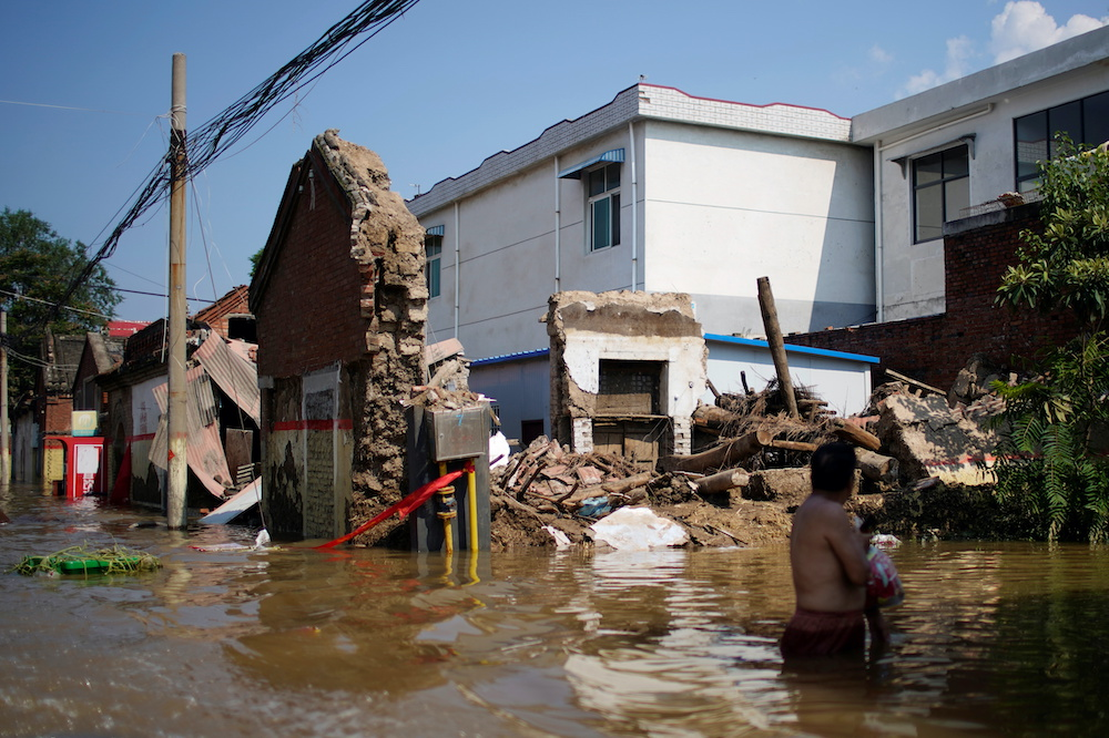 Flooded houses are seen at a village following heavy rainfall in Xinxiang, Henan province, China July 24, 2021. — Reuters pic