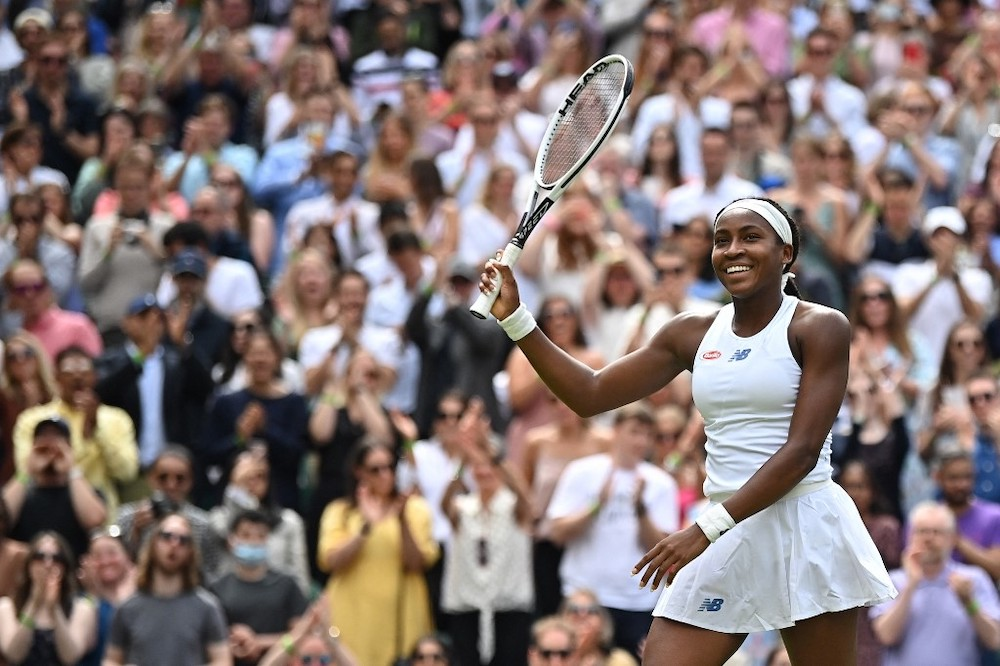 US player Coco Gauff celebrates her win against Slovenia's Kaja Juvan during their women's singles third round match on the sixth day of the 2021 Wimbledon Championships at The All England Tennis Club in Wimbledon, southwest London, on July 3, 2021. �