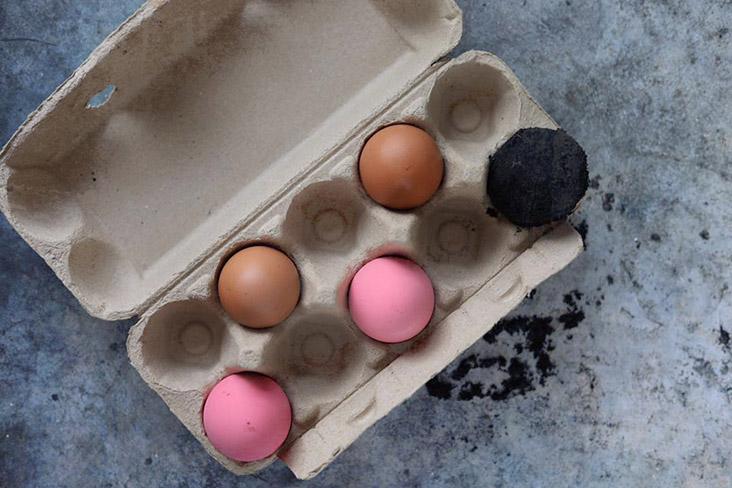 A 'rainbow' of eggs in the carton.