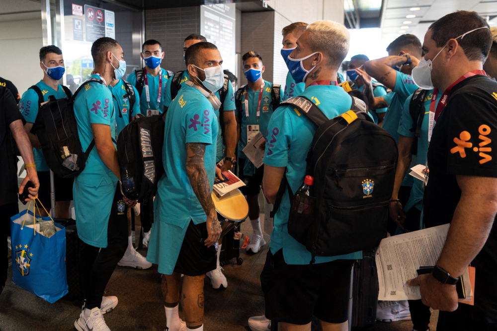 Dani Alves (centre left) and other members of Brazil's football team arrive for the Tokyo 2020 Olympic Games at Narita International Airport in Narita, Chiba prefecture July 17, 2021. —Reuters pic