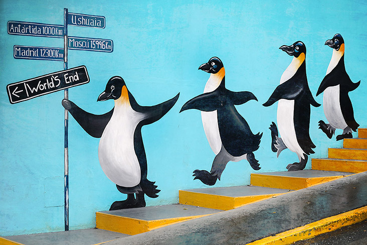 At the World's End, the penguins parade on murals... perhaps showing the way to the nearest empanadas!
