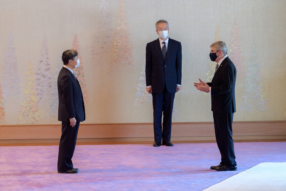 Japan's Emperor Naruhito (left) talking with International Olympic Committee president Thomas Bach during a meeting at the Imperial Palace ahead of the 2020 Olympic Games in Tokyo, July 22, 2021. — Imperial Household Agency handout pic via AFP