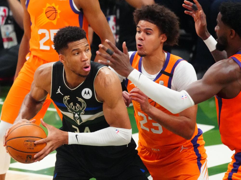 Milwaukee Bucks forward Giannis Antetokounmpo (34) drives against Phoenix Suns forward Cameron Johnson (23) during game six of the 2021 NBA Finals at Fiserv Forum. Mandatory — Mark J. Rebilas/USA TODAY Sports via Reuters