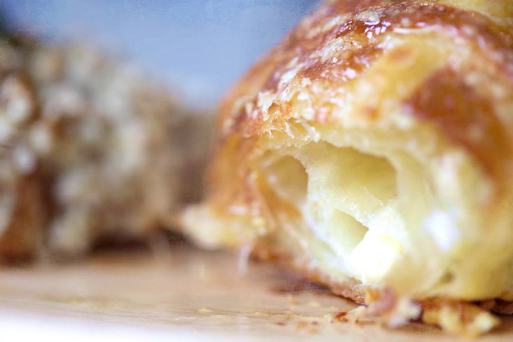 Artisanal baked pastries such as croissants are baked fresh daily by Teh's father.