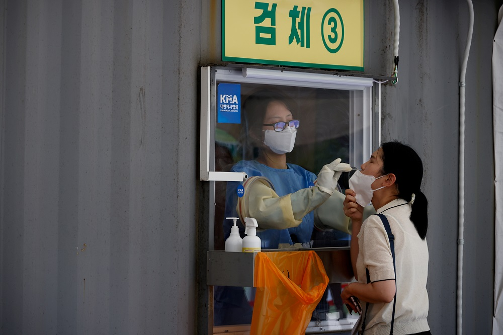 A woman gets tested for Covid-19 in Seoul, South Korea July 15, 2021. ― Reuters file pic