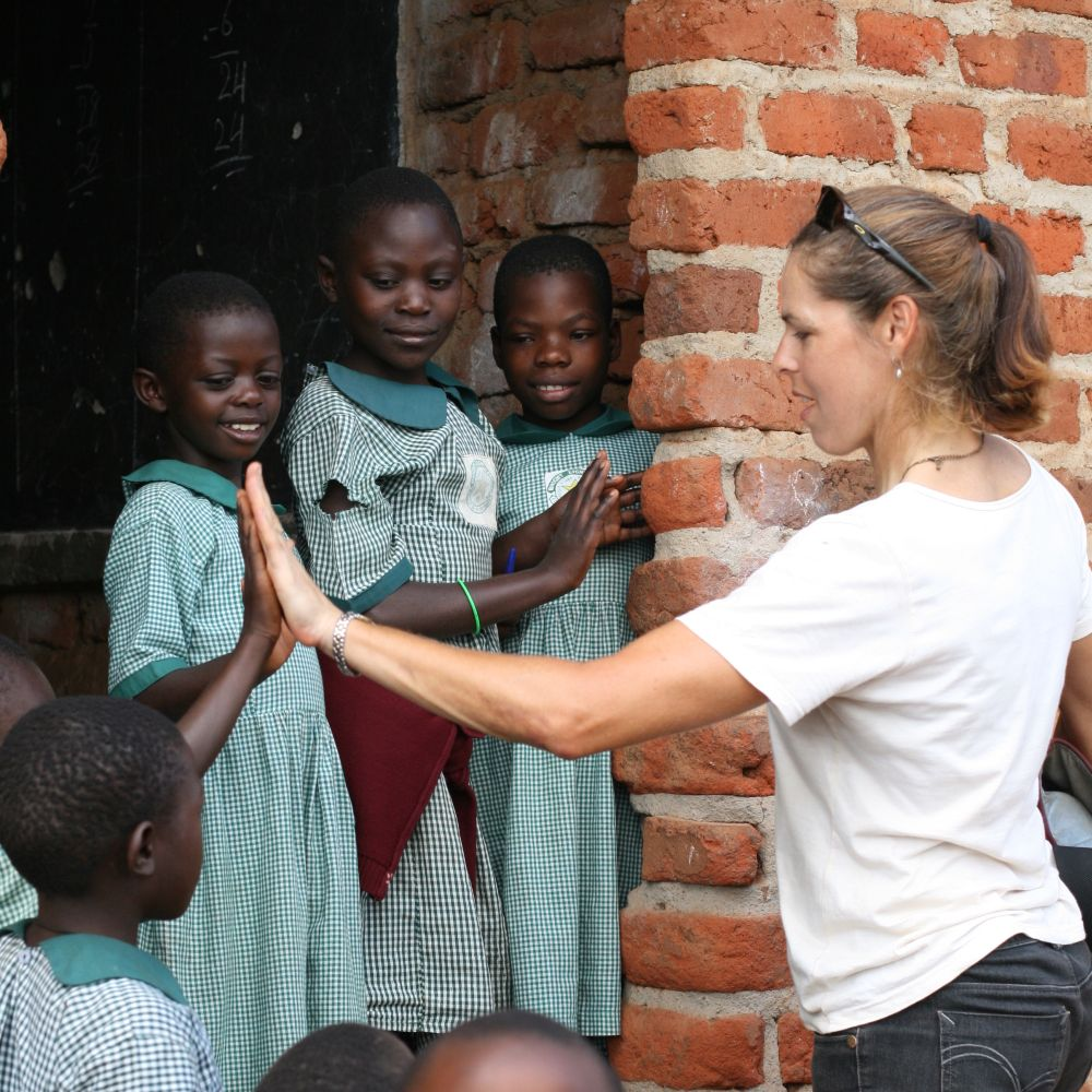 Leeming meeting primary school students during a previous trip to Uganda. — Picture courtesy of National Geographic