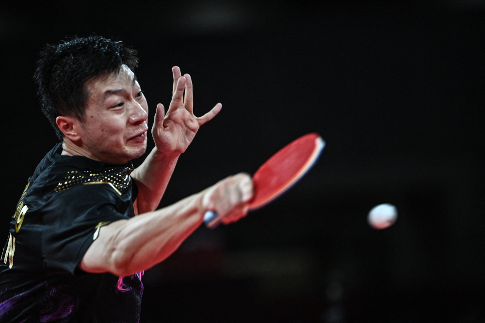 China's Ma Long competes against China's Fan Zhendong during the men's singles final table tennis match at the Tokyo Metropolitan Gymnasium during the Tokyo 2020 Olympic Games, July 30, 2021. — AFP pic