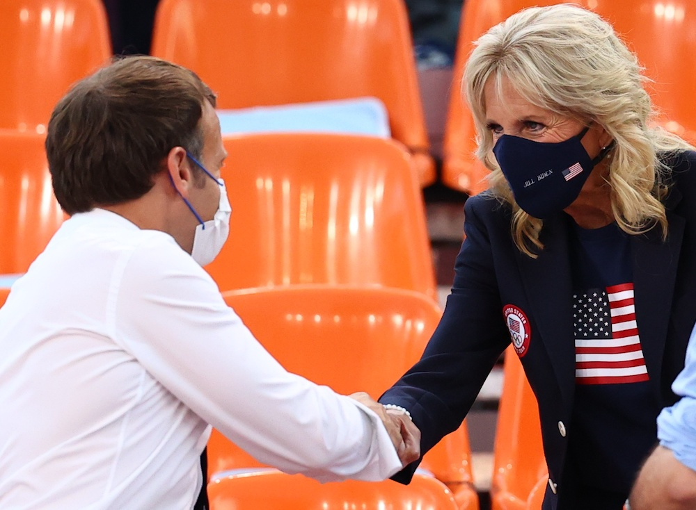 France president Emmanuel Macron greets US First Lady Jill Biden as they attend the US-France basketball match at the Aomi Urban Sports Park in Tokyo, July 24, 2021. — Reuters pic