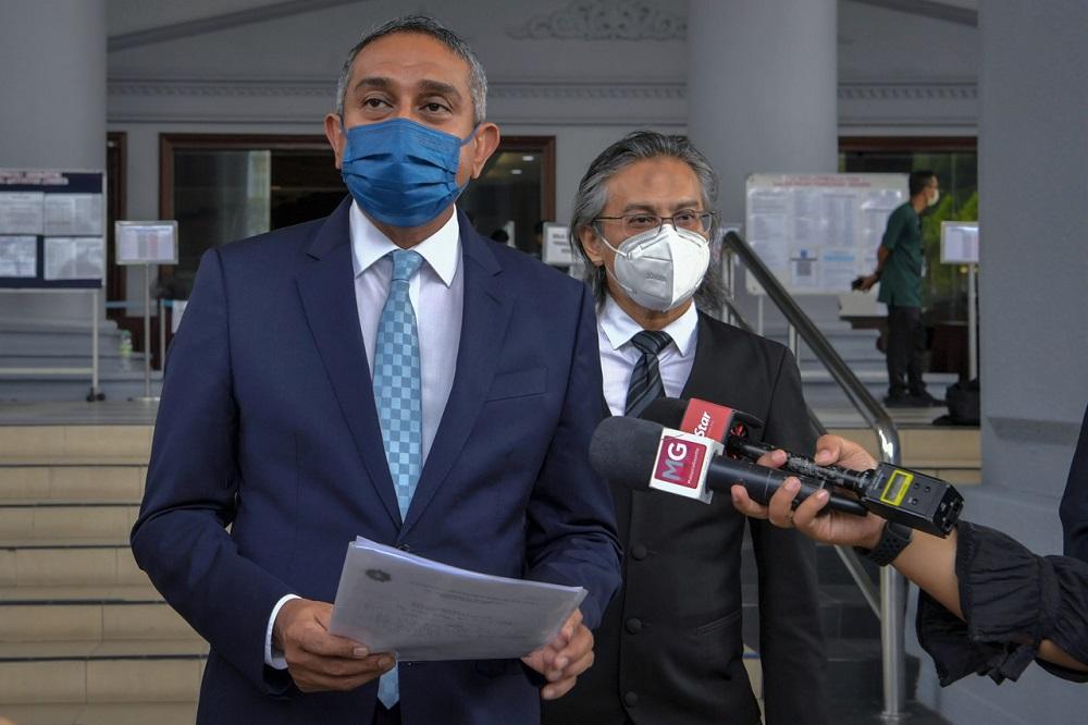 Umno lawyer Datuk Mohd Hafarizam Harun speaks to reporters outside the Sessions Court in Kuala Lumpur July 30, 2021. ― Bernama pic