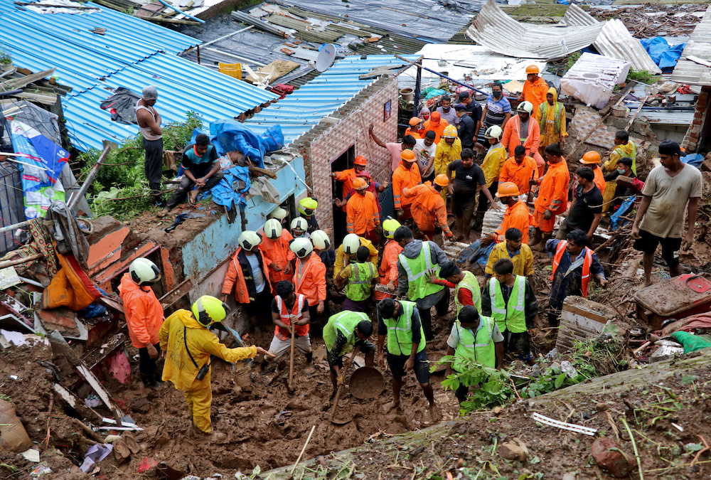 Rescue workers search for survivors after a residential house collapsed due to landslide caused by heavy rainfall in Mumbai, India, July 18, 2021. — Reuters pic
