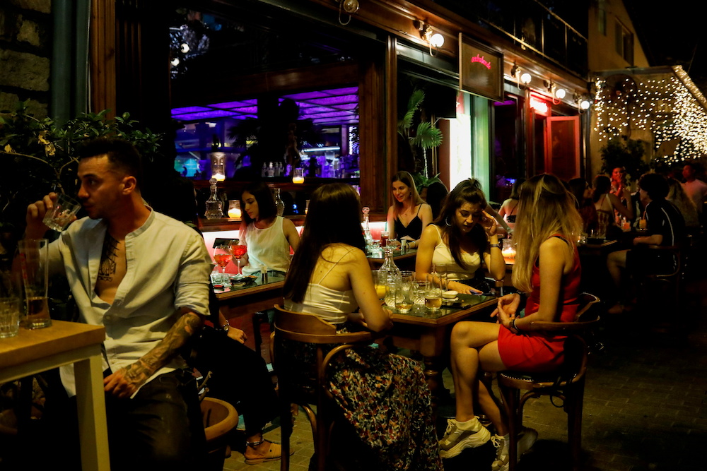 People sit at a bar, amid the spread of the coronavirus disease, in Athens, Greece, July 6, 2021. — Reuters pic