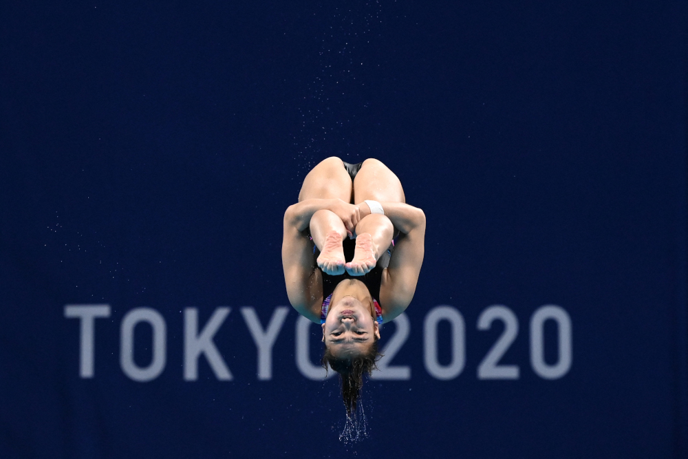 Malaysia's Nur Dhabitah Sabri competes in the preliminary round of the women's 3m springboard diving event during the Tokyo 2020 Olympic Games at the Tokyo Aquatics Centre in Tokyo July 30, 2021. — AFP pic