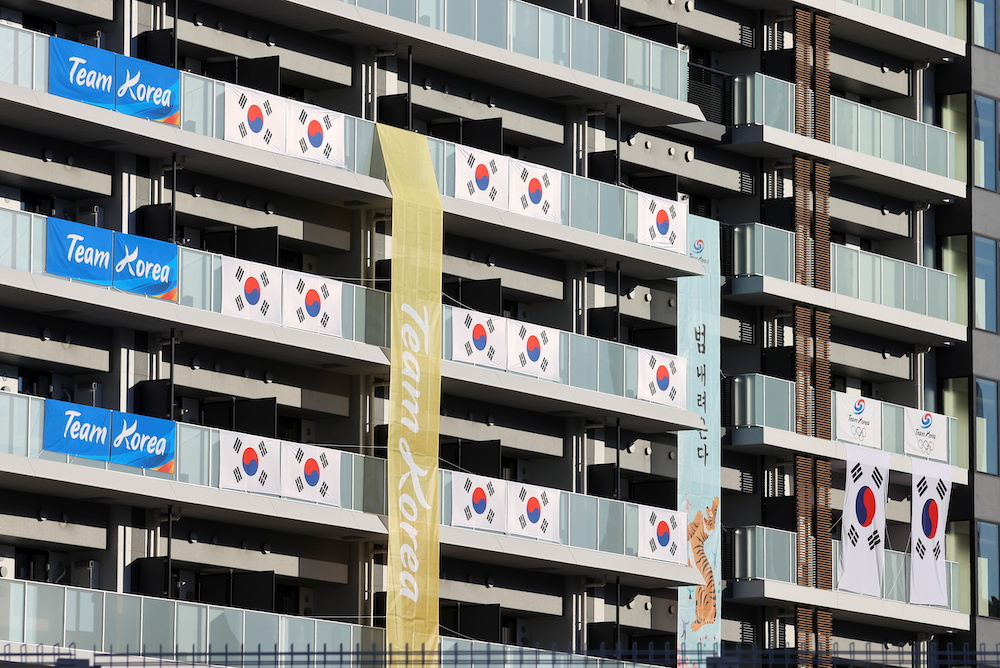 South Korean Flags and signs hang on the appartment building hosting Olympics participants, at the Athletes Village, where a person has tested positive for Covid-19, ahead of Tokyo 2020 Olympic Games in Tokyo, Japan July 17, 2021. — Reuters pic