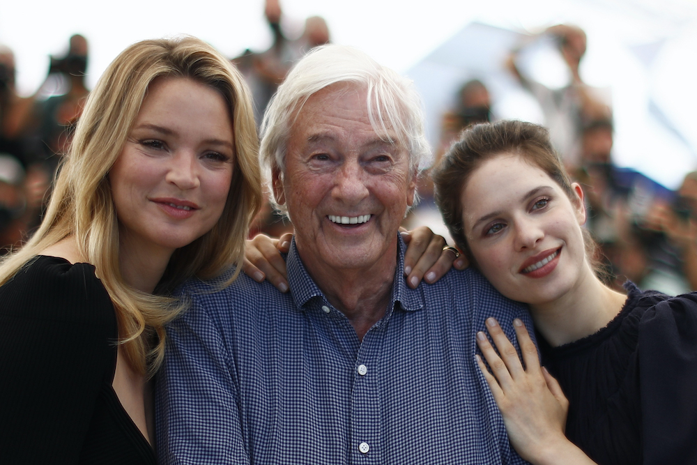 Director Paul Verhoeven and cast members Virginie Efira and Daphne Patakia pose at the 74th Cannes Film Festival in Cannes, July 10, 2021. — Reuters pic