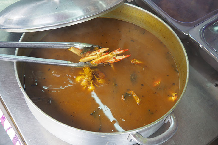 The regulars of Nasi Lemak Ray Power will put in requests for certain items like this crab 'rasam'