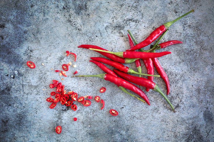 Red hot chillies are a must to give this red chicken its pedas kick.