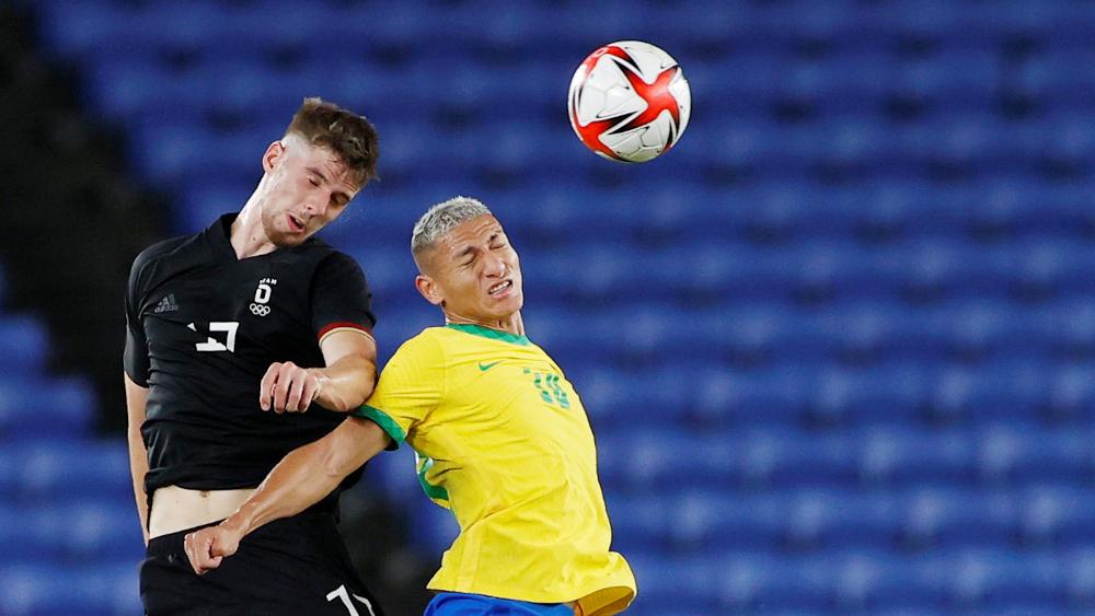 Richarlison of Brazil in action with Anton Stach of Germany at the International Stadium Yokohama, Yokohama, Japan, July 22, 2021. — Reuters pic