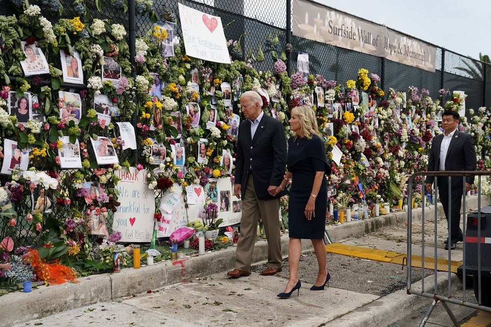 US President Joe Biden and first lady Jill Biden visit a memorial put in place for the victims of the building collapse in Surfside, in Tent city area, Surfside, Florida July 1, 2021. ― Reuters pic