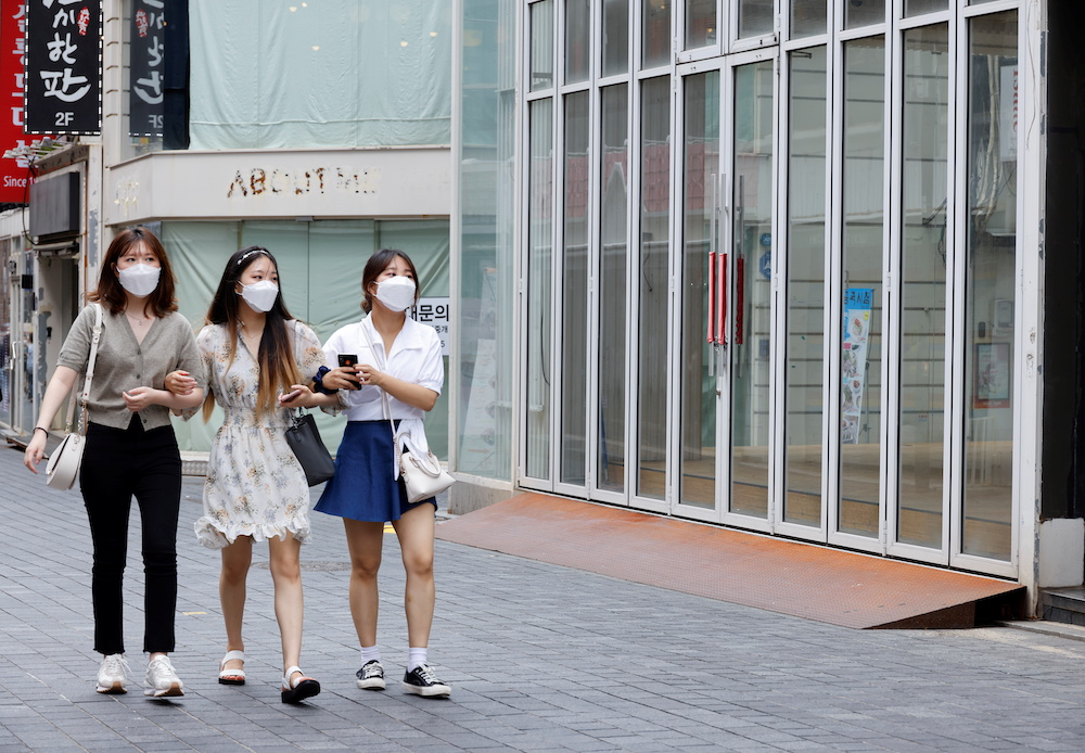 Women wearing masks walk in a shopping district amid the Covid-19 pandemic in Seoul, South Korea, July 9, 2021. — ETX Studio pic