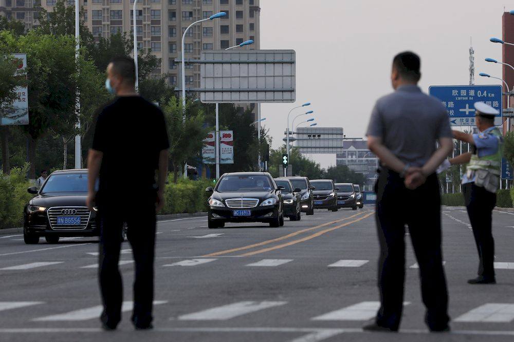 A convoy of vehicles arrives to a hotel where US Deputy Secretary of State Wendy Sherman is expected to meet Chinese officials, in Tianjin, China July 25, 2021. — Reuters pic