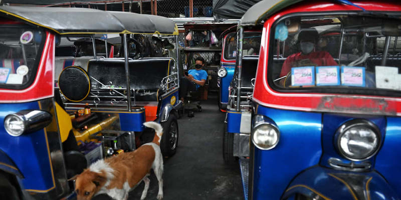 Tuk-tuks and garishly coloured taxis that once weaved through chaotic Bangkok traffic are sitting idle in storage. — Reuters