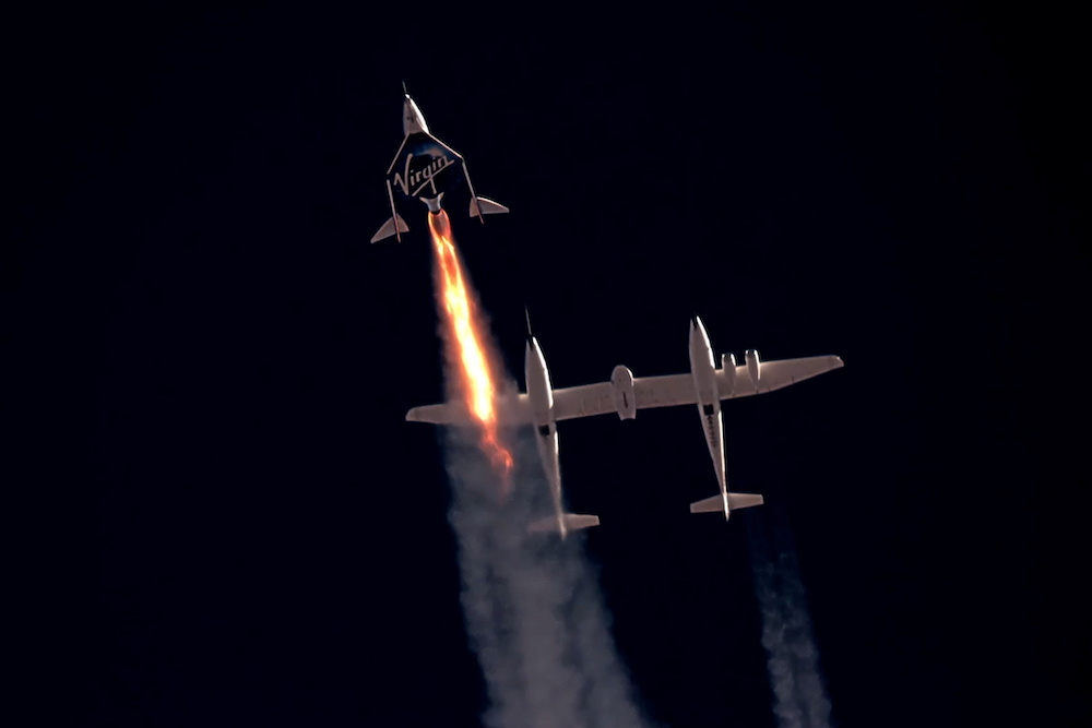 Virgin Galactic's passenger rocket plane VSS Unity, carrying Richard Branson and crew, begins its ascent to the edge of space above Spaceport America near Truth or Consequences, New Mexico, US July 11, 2021 in a still image from video. — Reuters pic