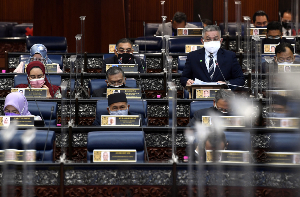 Health Minister Datuk Seri Dr Adham Baba tabling a briefing session on Actions to Combat Covid-19 Pandemic at the special sitting of Dewan Rakyat, July 27, 2021. — Bernama pic