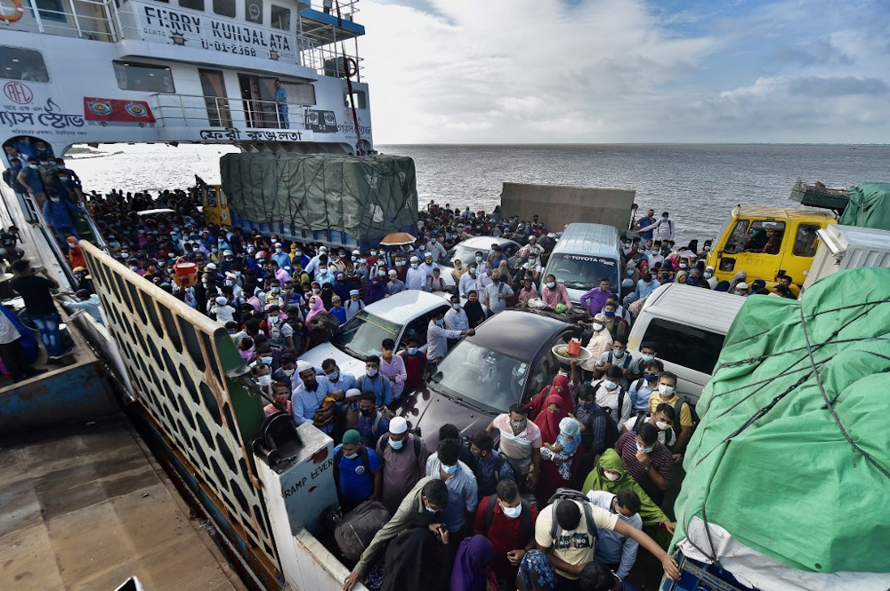 People wait to disembark from a ferry in Sreenagar on July 31, 2021 after they return to their work areas as Bangladesh relaxed the lockdown norms for all export-oriented factories earlier imposed to curb the spread of Covid-19. — AFP pic