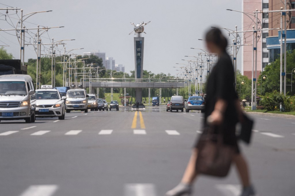 Traffic makes its way along a street during high temperatures reaching 34 degrees Celsius in Pyongyang on July 21, 2021. — AFP pic