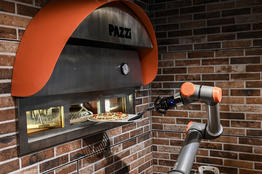 This photograph taken on July 1, 2021, shows 'Pazzi', a pizza-making robot at work in a restaurant in Paris. — AFP pic